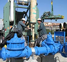 Workers Installing a New Groundwater Well Pump